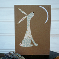 Greetings card with moon staring hare