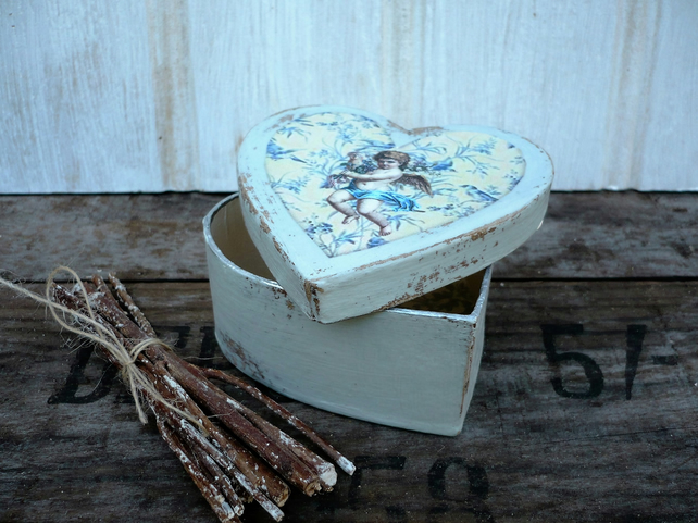 Heart shaped trinket or gift box with angel