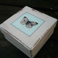A gift box with decoupaged butterfly