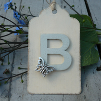 Gift tag with personalised initial and butterfly