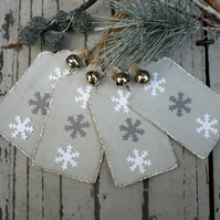 Hand made christmas gift tags with grey and white snowflakes