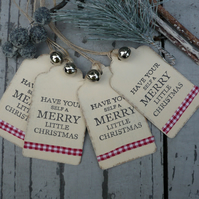 Hand made christmas gift tags with jingle bell