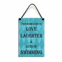This Home Runs On Love Laughter & Swimming Handmade Home Sign 460