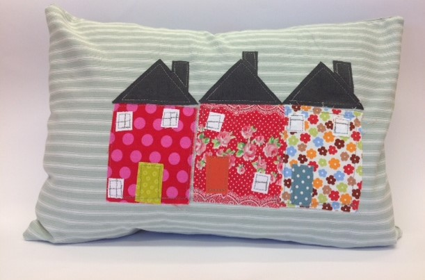 Rectangular cushion with an applique design of houses