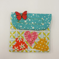 Lovely applique coin purse.