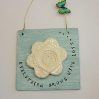 everything grows with love plaque