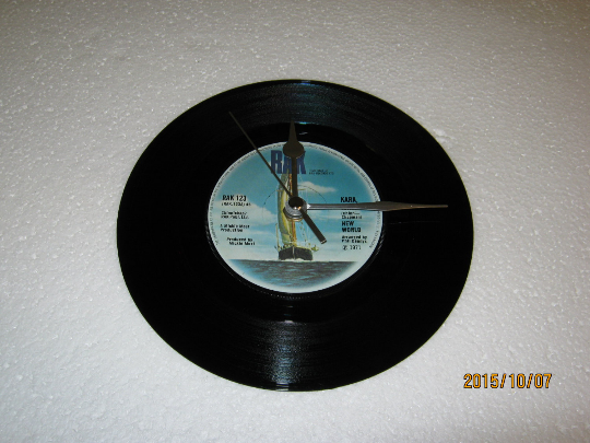 "New World - ""Kara, Kara"" 7"" Vinyl Record Wall Clock"