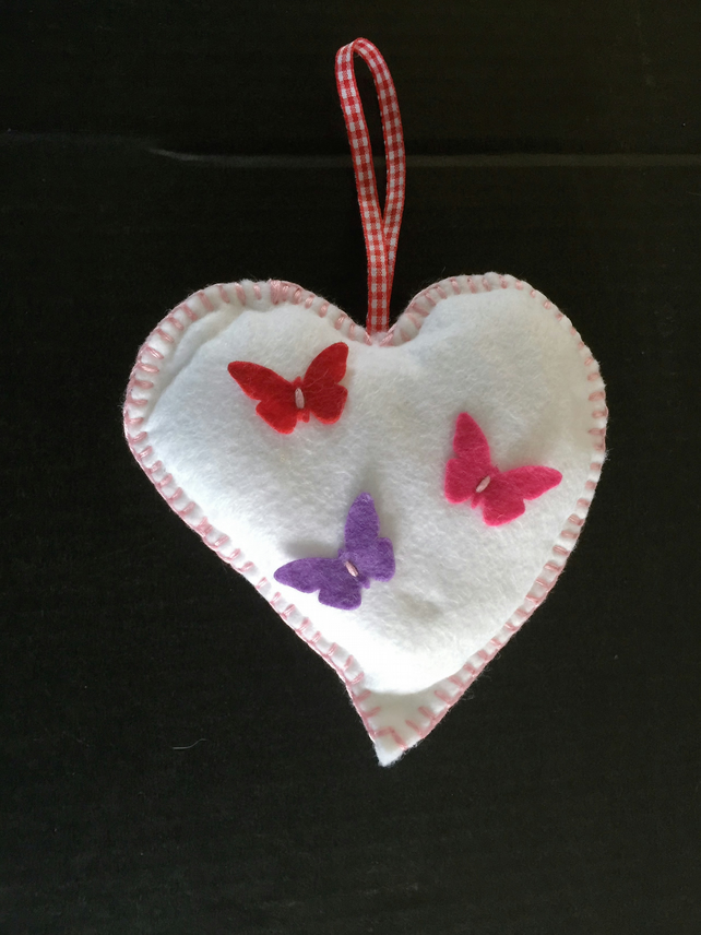 White felt heart with butterfly decoration