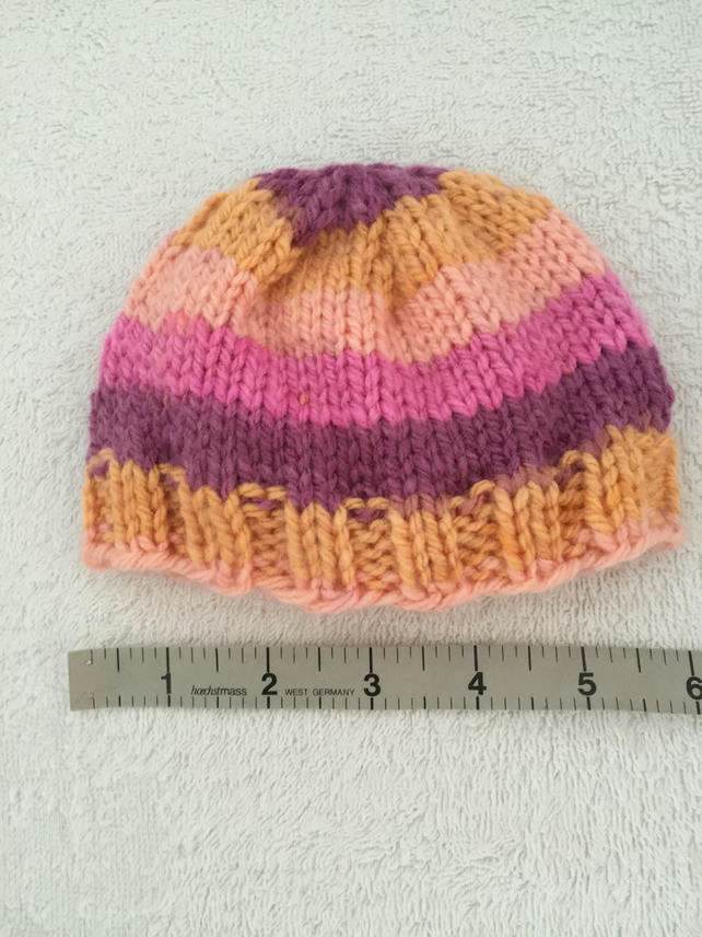 Pink,purple and orange striped baby pull on hat, 0-6 months