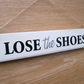 Lose The Shoes sign.