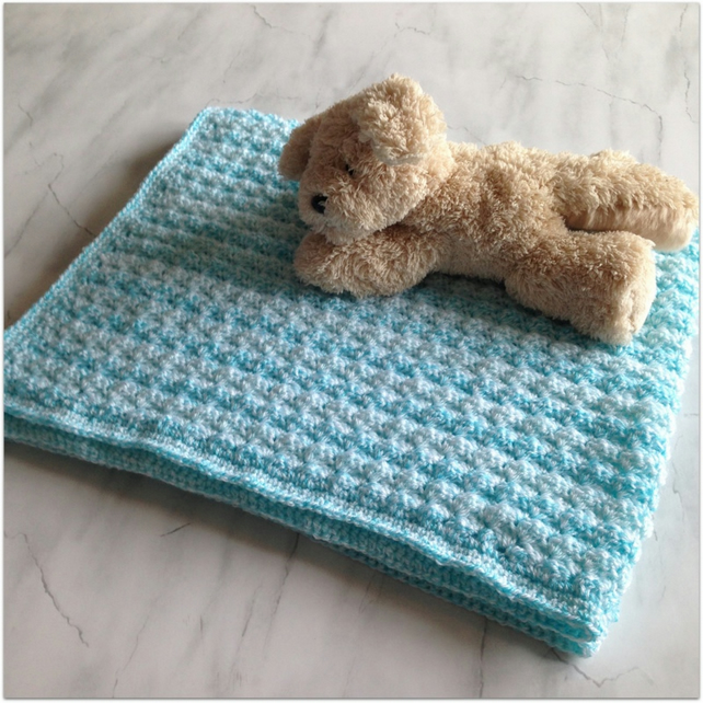 Hand Crocheted Baby Blanket in shades of aqua to fit pram or cot