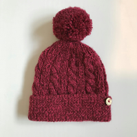 Hand knitted Child's Hat with pompom in burgundy -  4 to 7 years