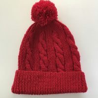 Hand knitted child's red winter hat cable with pompom age 3 - 6 years approx