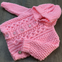 Hand knitted Girl's Aran Hooded Cardigan aged 6 - 12 months in Pink