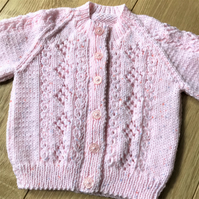 Hand knitted girl's baby cardigan to fit up to 12 months