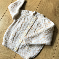 Hand knitted baby girl's cardigan to fit up to 9 months with lace and cable patt