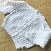 Hand knitted baby girl's cardigan to fit up to 12 months
