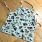 "Kid's adjustable cotton apron - age 18 months upwards - length 19"" - transport"