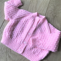 Hand knitted baby girl's cardigan to fit up to 6 months in candyfloss pink