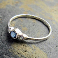 Thin sterling silver and blue sapphire ring