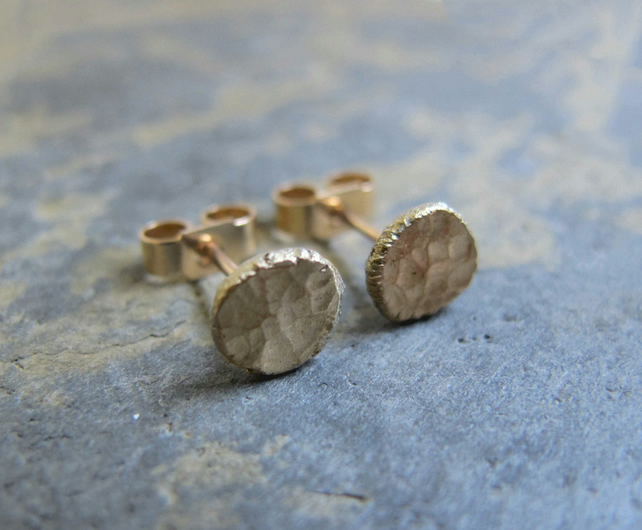 Gold stud earrings with a hammered surface