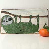Painting on reclaimed wood of a sloth
