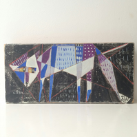 Geometric painting on reclaimed wood of a cat