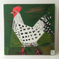 Geometric painting on reclaimed wood of a hurrying hen