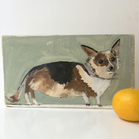 Painting on reclaimed wood of a corgi dog