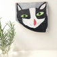 Painting on reclaimed wood of a black and white cat