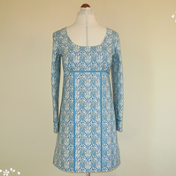 Blue Floral 1960s Mini Dress with Low Neckline and Long Sleeves