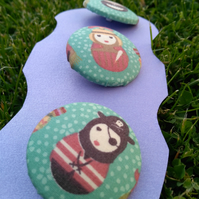 Three large (38mm wide) buttons with cute characters (roman, pirate and maid)