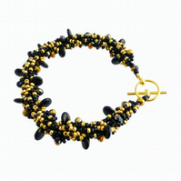 Black and Gold Spiral Bracelet, Hand stitched Beadwork Bracelet
