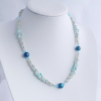 Blue Spiral Beadwork Necklace with Fossil beads