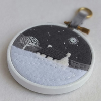"Hand-embroidered Winter Landscape with Cottage and Tree in 3"" Painted Hoop"
