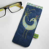 Denim blue glasses case with peacock appliqué