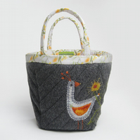 Charcoal grey project bag with appliqué bird and marigold embroidery