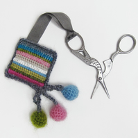 Scissor keeper with needlepoint stripes and crochet trim with balls