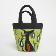 Tiny green bag with cat print and cat appliqué