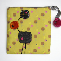 Mustard make up bag with mid-century sculpture print and appliqué