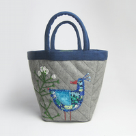 Grey project bag with appliqué bird