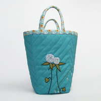 Large turquoise linen project bag with clover and bluebell embroidery