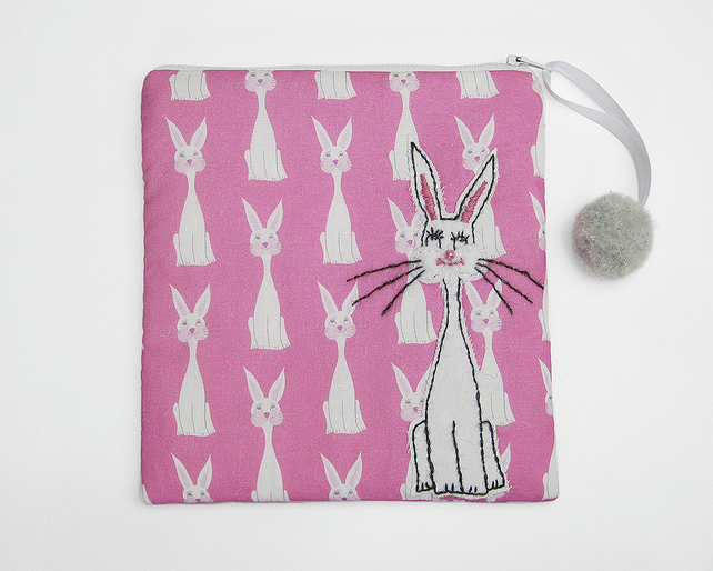 Pink make up bag with rabbit print and rabbit appliqué