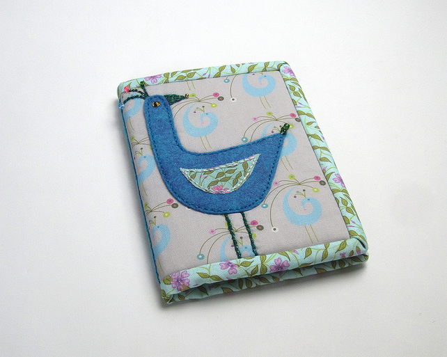 A6 notebook with peacock print and bird appliqué