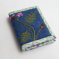 A7 notebook in denim blue wool felt with herb Robert embroidery