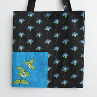 Black thistle print tote bag with hand embroidered dead nettle and fully lined