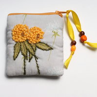 Pale grey thistle print purse with hand embroidered yellow clover