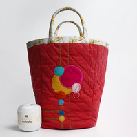 Big Cherokee red project bag with appliquéd circles design