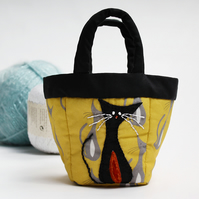 Tiny yellow bag with cat print and cat appliqué