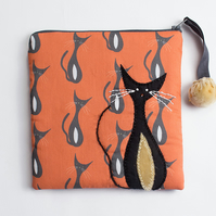 Orange and grey make up bag with mid century cat print and appliqué